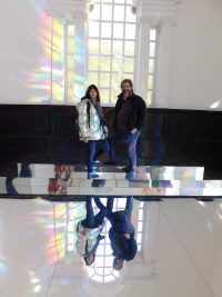 "Beverley and Keith stood for a photo on some mirroed steps and flooring invthe 'To Breathe"" exhibit at Yorkshire Sculpture Park"
